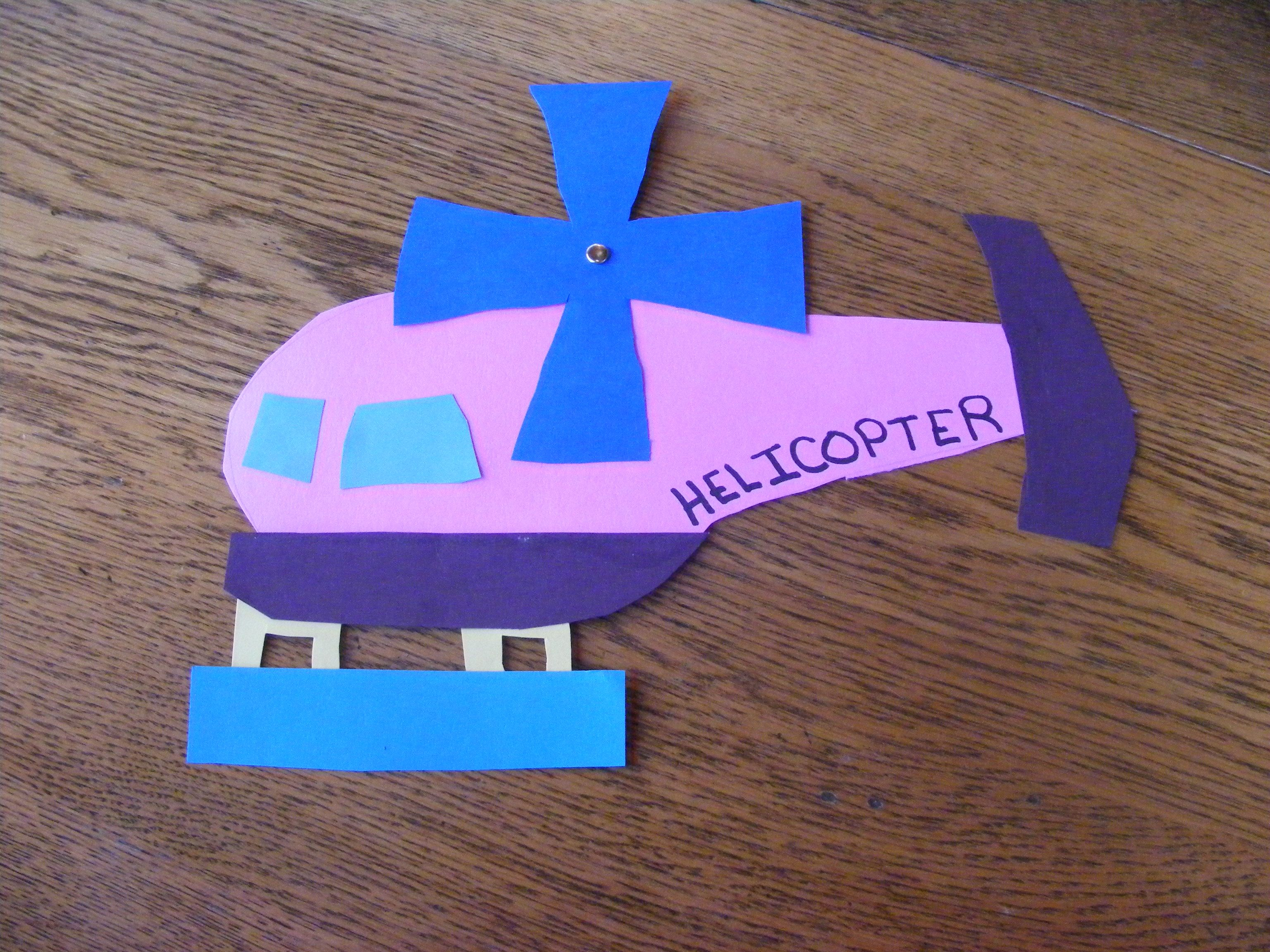 We cut out and glued together pieces of a helicopter for H.