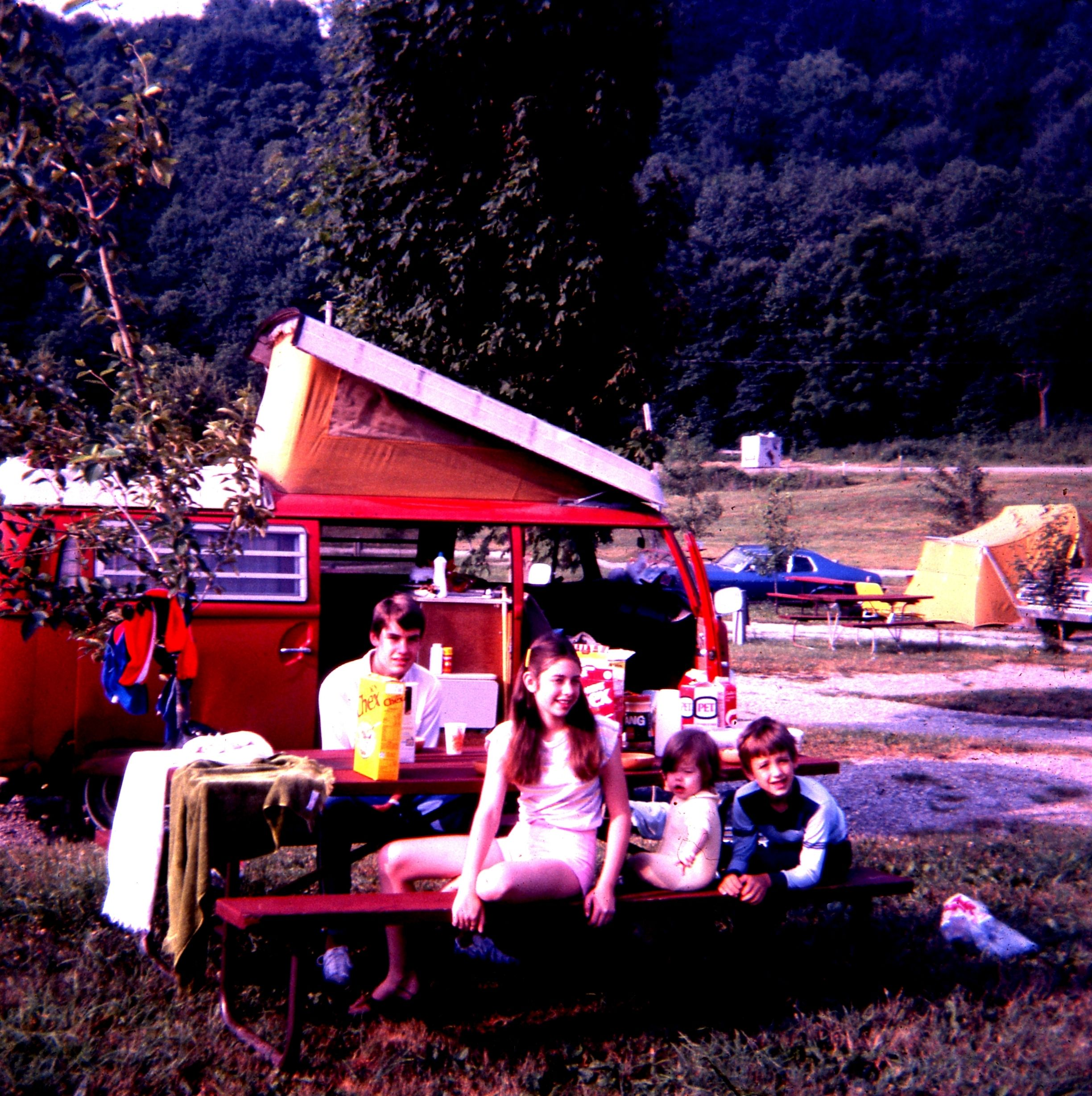 My four children having breakfast in front of our VW camper on our two month camping trip from New Orleans to Newfoundland.