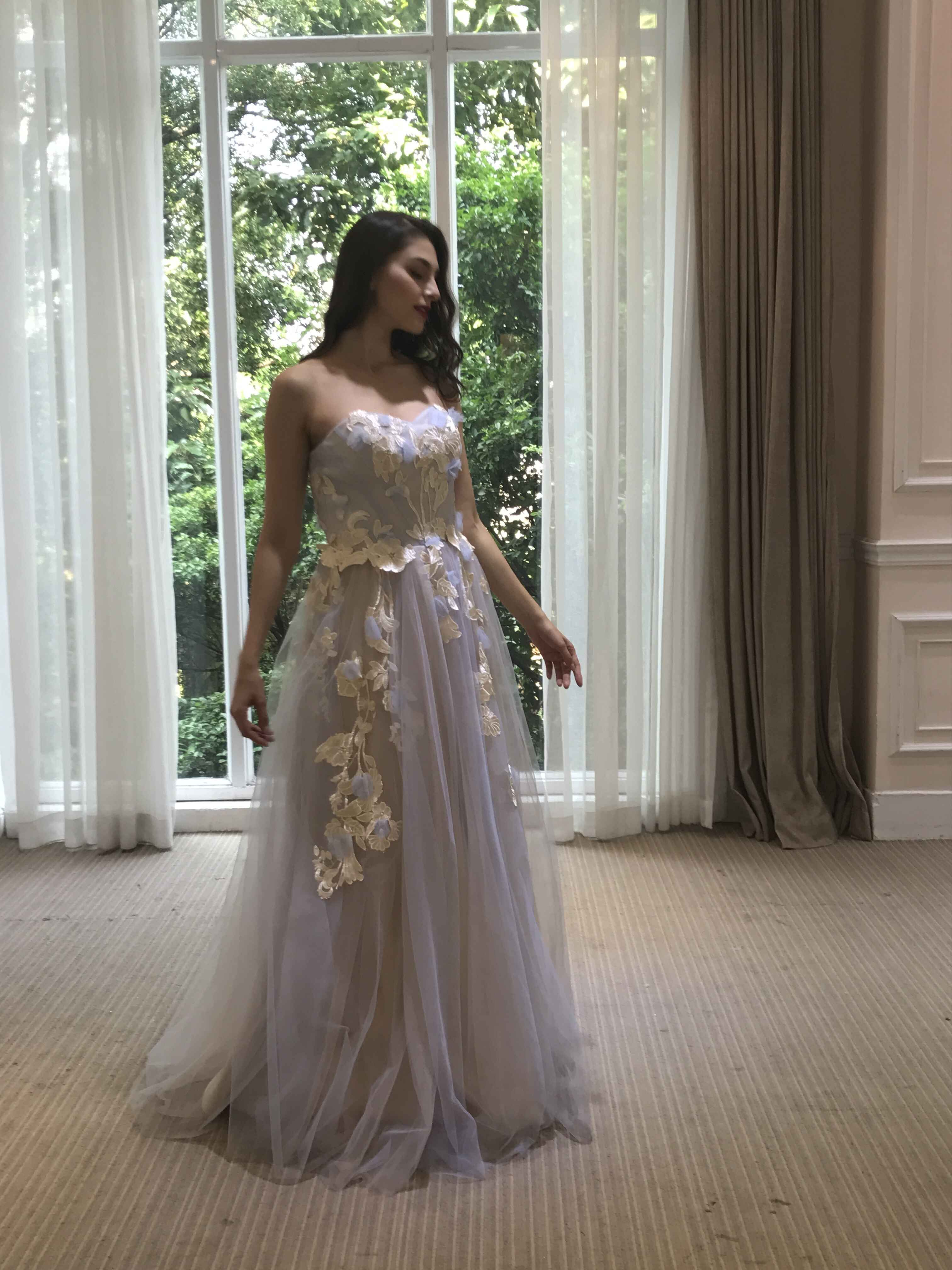 Pastel colored strapless wedding dress with embroidery