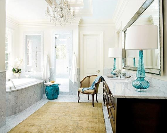 A touch of Luxe: 7 beautiful romantic bathrooms. I love the Idea of the lamp in the bathroom. This lamp is very similar to the one in my bedroom.