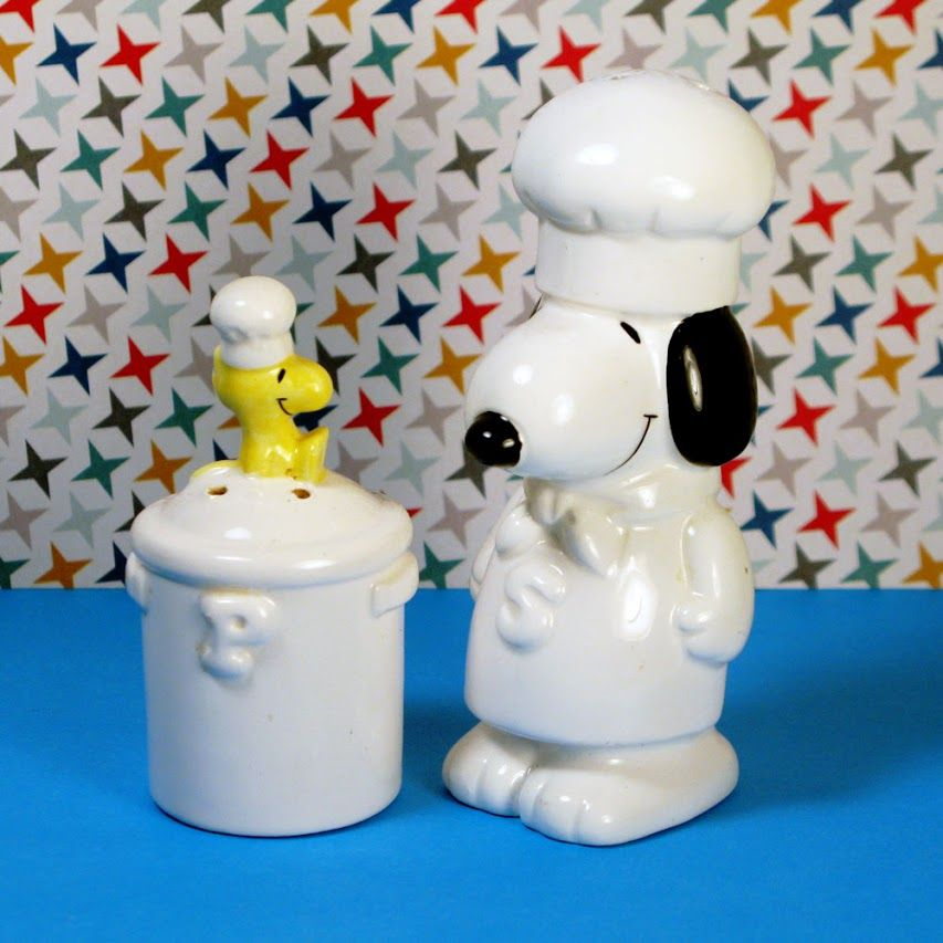 For Sale - Snoopy & Woodstock Salt & Pepper Shakers - Shake, Shake, Shake! Shake your Snoopy! Make every meal more delightful with spices by Chefs Snoopy and Woodstock. The vintage salt and pepper pair was made in 1977 by Determined Productions. Find the kitchen tableware set in our shop at CollectPeanuts.com.