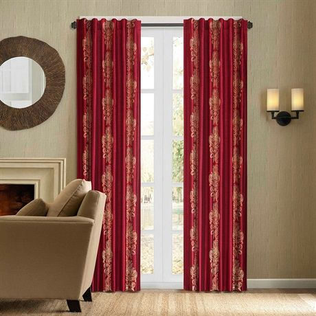 """Give your room a new look with the Madrid window panel. The panel is made of luxurious red faux silk fabric with chain-stitch embroidery in a beautiful gold scroll medallion motif. This energy saving panel is lined and feature interlining with fleece material to retain the heat or keep cool air from escaping your room. The top treatment is a back tab and rod pocket details for multi hanging options and will fit up to 1.25"""" diameter rod.  The panel comes in 84"""" and 95"""" length."""