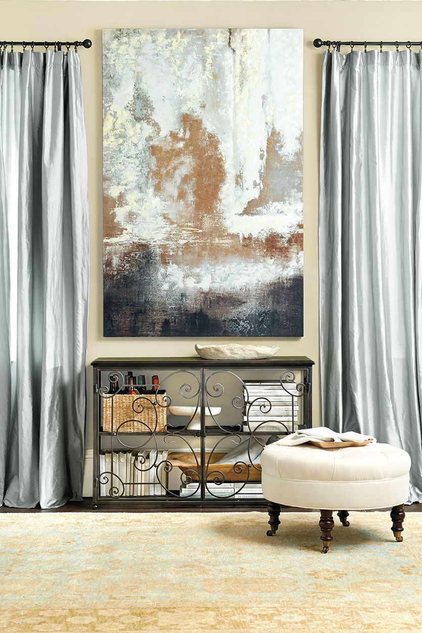 Dramatic drapery panels are a great way to fill wall space