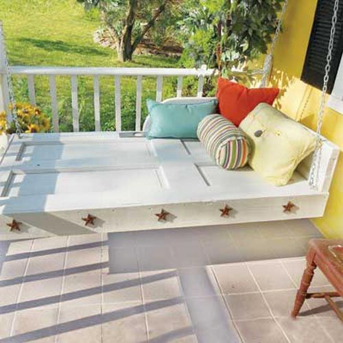 A swinging bed made from a recycled door!
