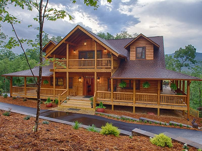 Log Home With Beautiful Wrap Around Porch And Upstairs