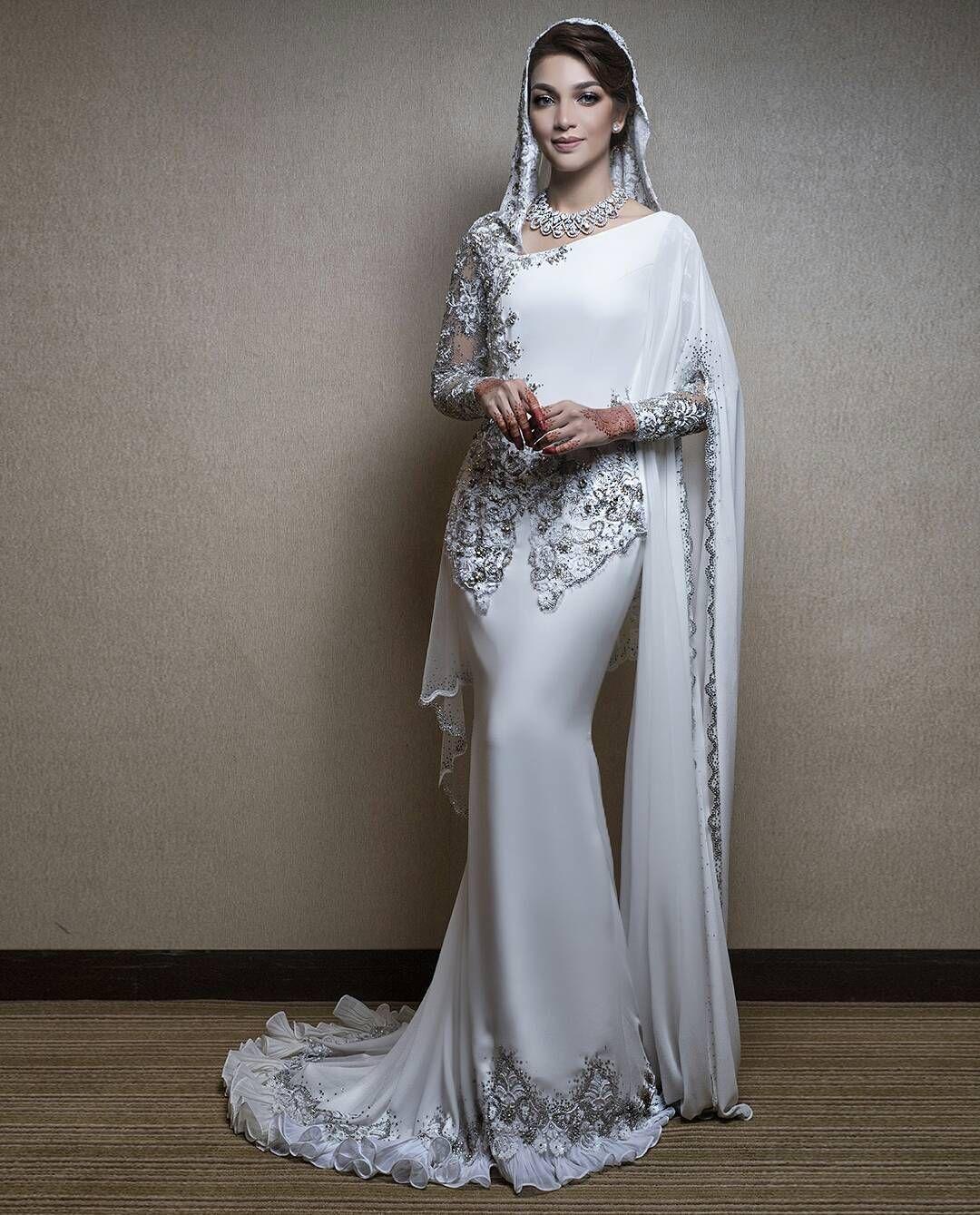 Amyra Rosli Wearing A Custom Kebaya Inspired Dress Rizmanruzaini