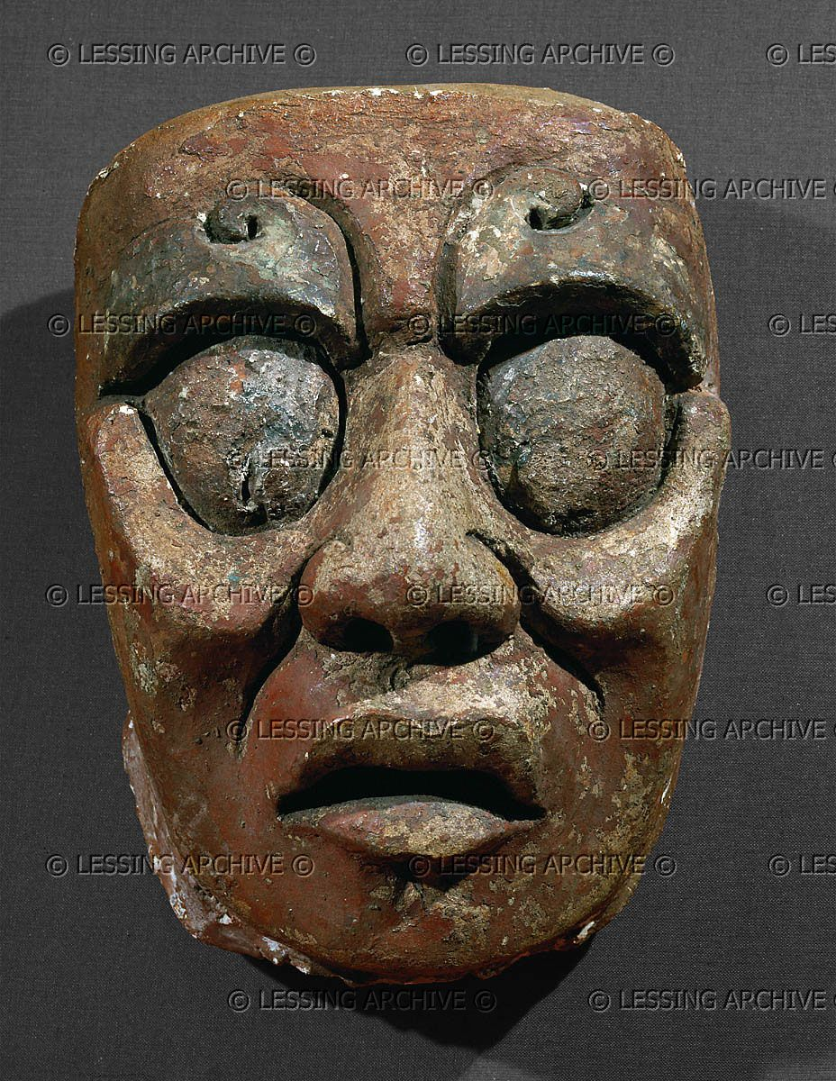 Portrait mask of the Sun God from the Sun Temple at Palenque, Mexico.Stucco, paint (600-900 CE). Maya