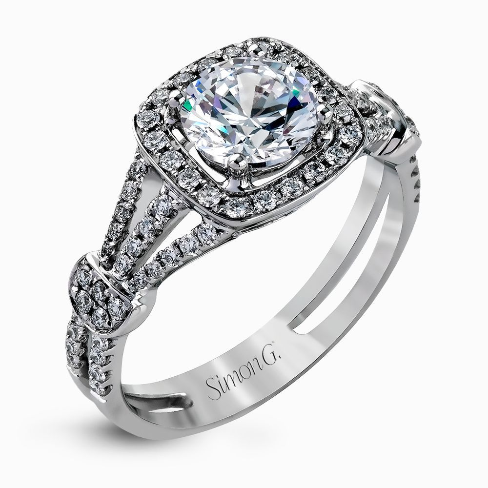 Now that's a lot of diamonds! This week's stunning Ring of the Week by Simon G - what a beauty! #ad