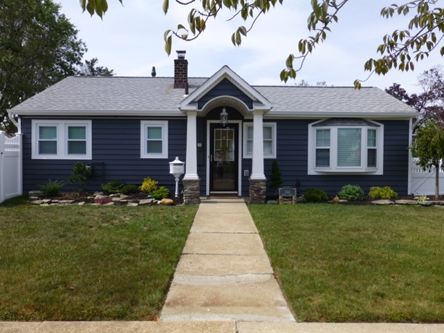 Improve The Appearance Of Your Home With Cedar Ridge Vinyl Siding This Siding Has The Look Of Real Wood With The Impact Resis House Siding Vinyl Siding Siding