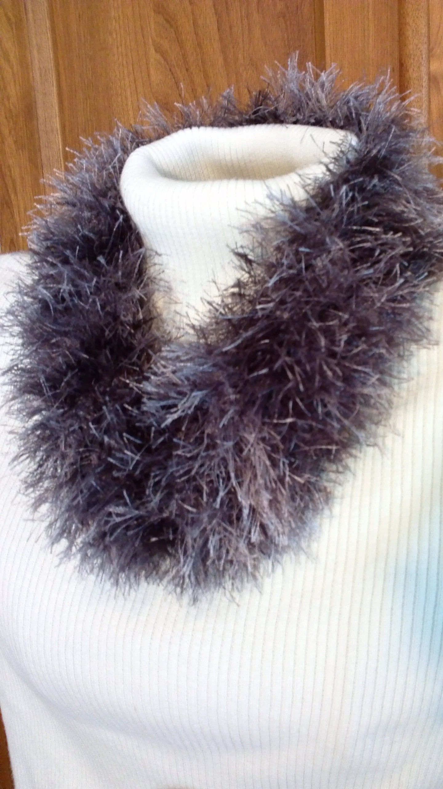 Knit cowl from 2 shades of gray eyelash yarn. This is from a Lion ...