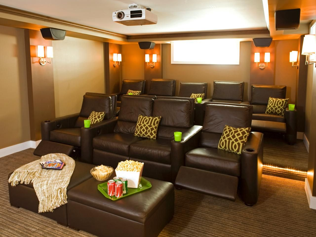 A simple sleek modern home theater features large automatic