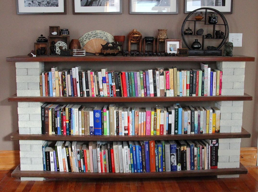 Diy board and block shelves from unique bookshelves for Unique shelves diy