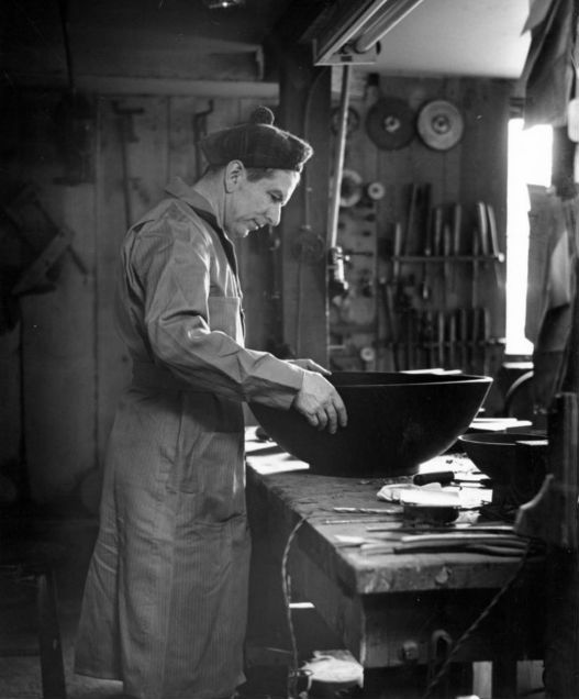 Stocksdale at work in his basement workshop on Oregon Street in Berkeley, California. For years Bob made salad bowl sets that were a favorite wedding gift at $50 or so a set.