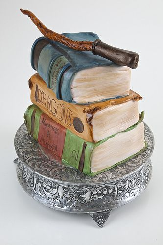 """Magician's Cake.  Is this Harry Potter inspired?  I can't quite read the book spines, apart from the middle one, which says """"DRAGONS."""""""