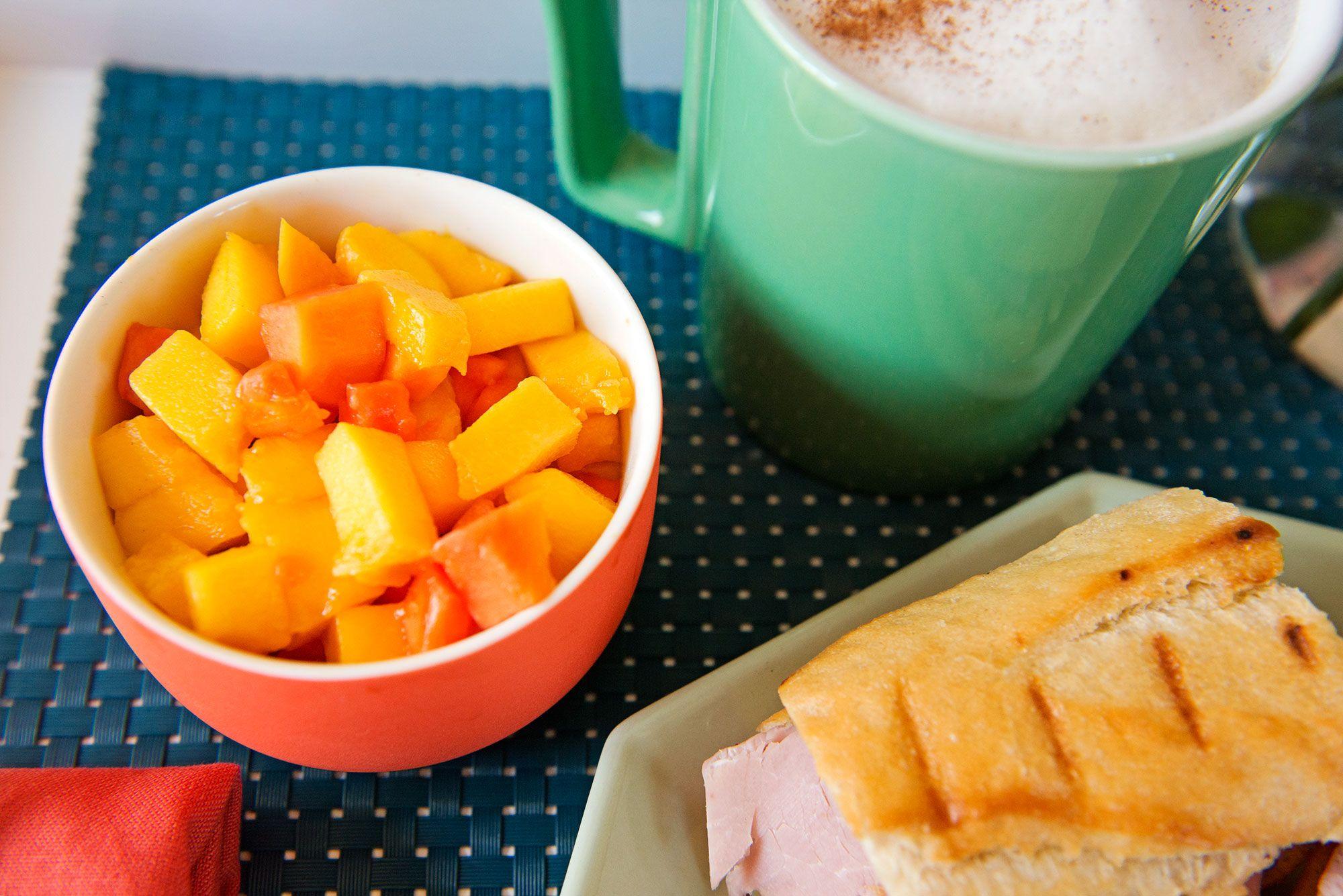 Fried egg cubano with papaya-mango salad and café con leche.