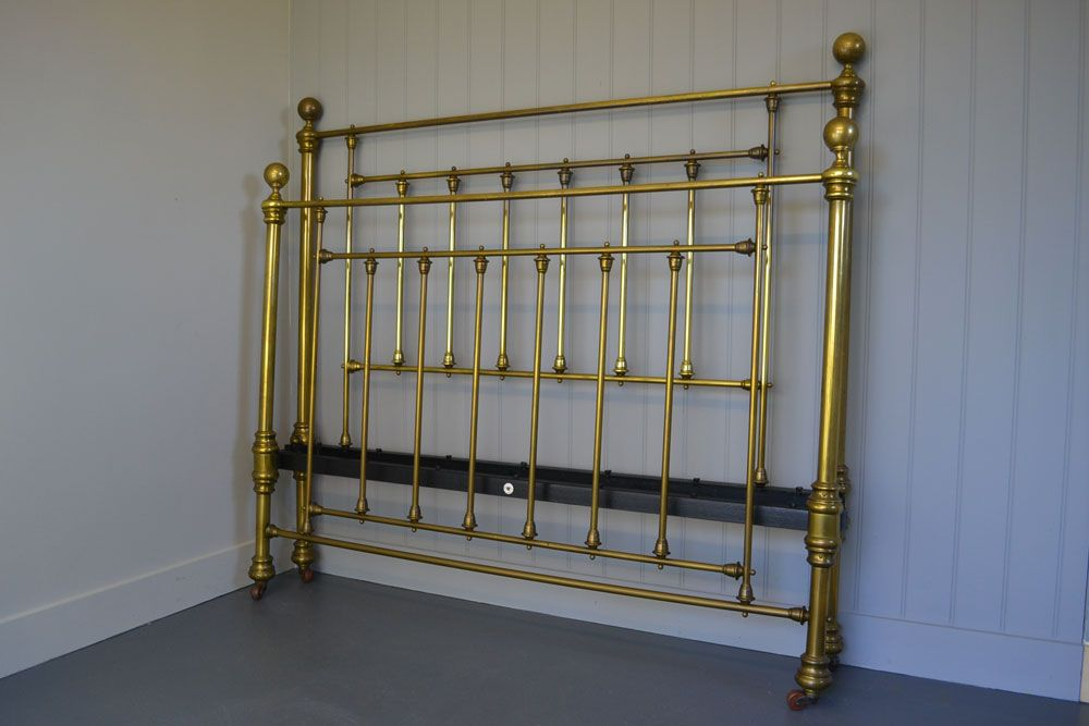 Maple & Co. London Victorian Brass king size 5ft bedstead. The bed has a lovely antique patina to the brass.It has been extended from 4ft 6in sometime in its life time but had a great look . Maple and co. were top furniture makers of their time and were based in Tottenham Court Road, London.