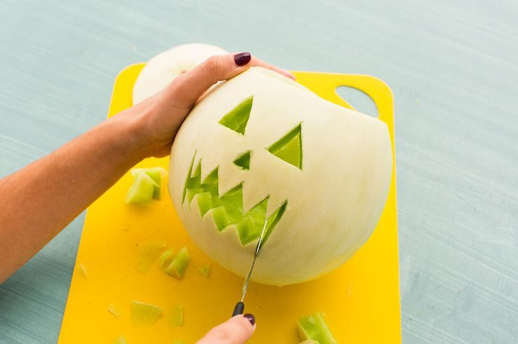 Carve up a melon for Halloween.
