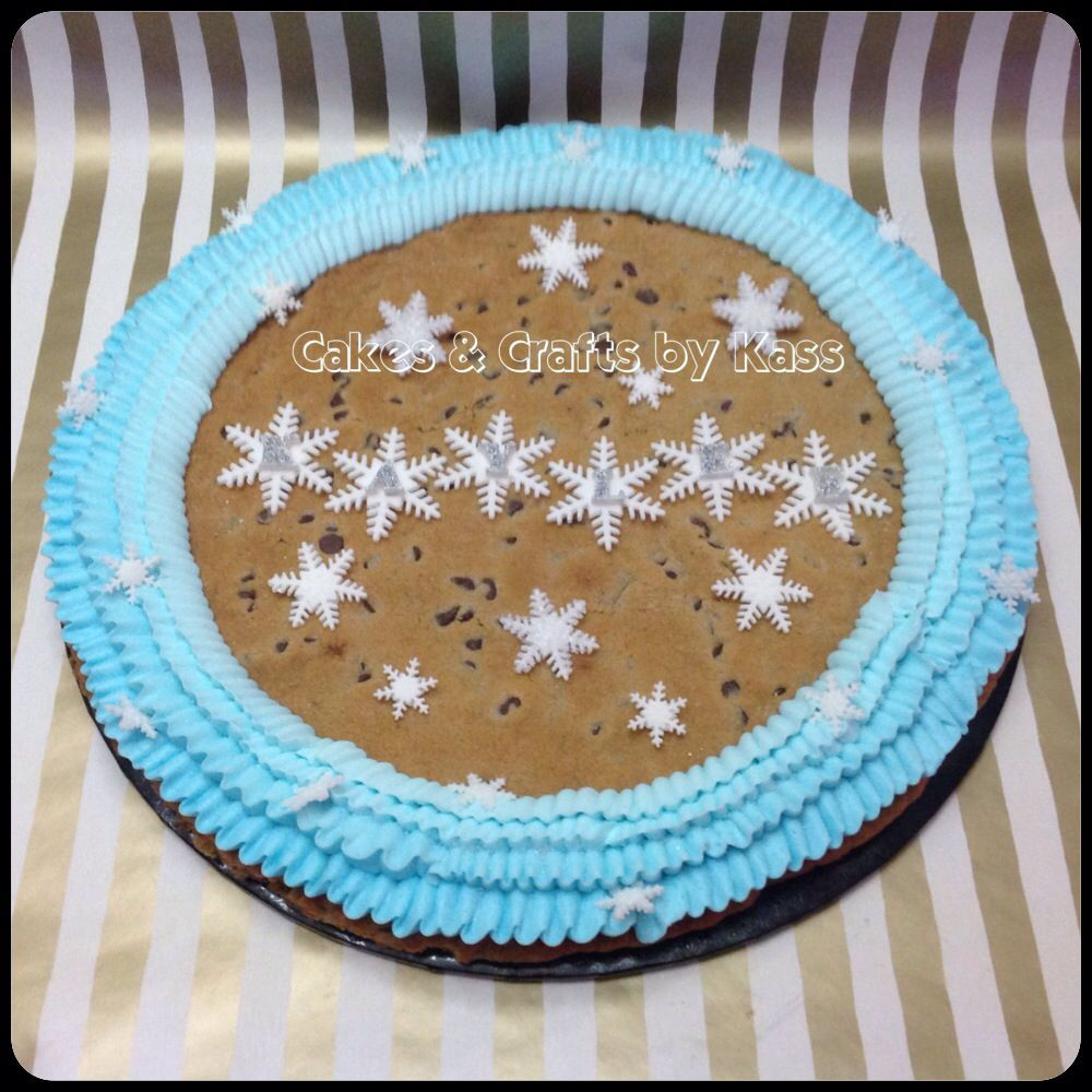 "GIANT 16"" Frozen themed chocolate cookie cake. Accented with blue ombré ruffles and fondant snowflakes."