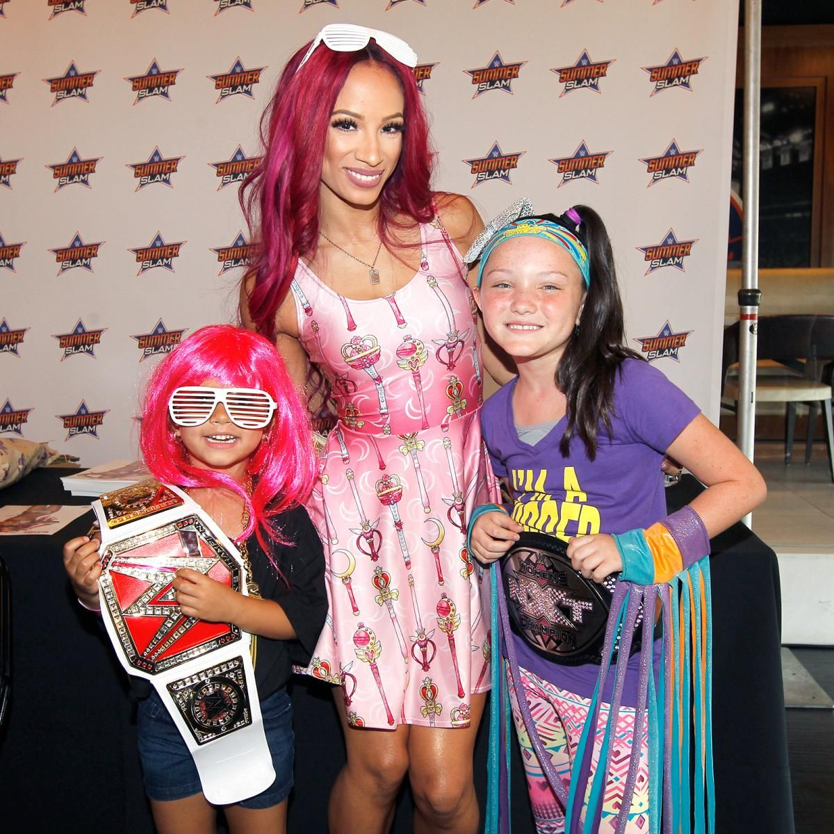 Dean ambrose and sasha banks host a vip signing at barclays center the wwe world champion and wwe womens champion welcomed members of the wwe universe to barclays center for an autograph signing and meet and greet kristyandbryce Choice Image