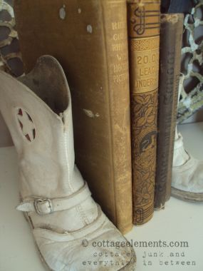 old books and baby boots....i still have some of my boots that I wore when I was little
