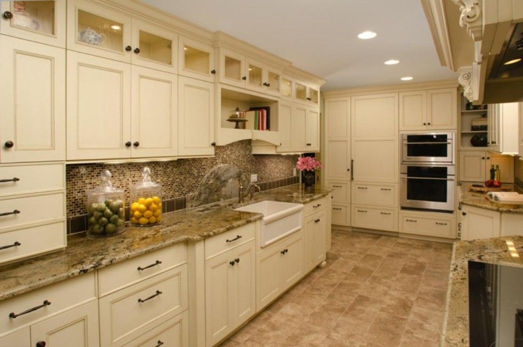Cream Cabinet Galley Kitchen With Off White Cabinets And Subway Tile Timeless Kitchen Backsplash Beige Kitchen Cream Kitchen Cabinets Kitchen Cabinet Design