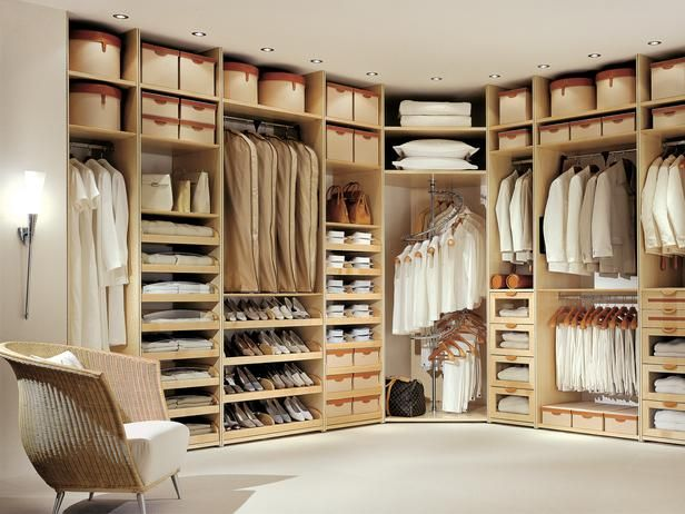 Timeless Style:  Clean, classic and neutral, this closet by Studio Becker feels like a fitting room in a high-end clothing store. The drawers and storage boxes feature hand-stitched leather pulls, and the shelves are crafted from quality maple wood.
