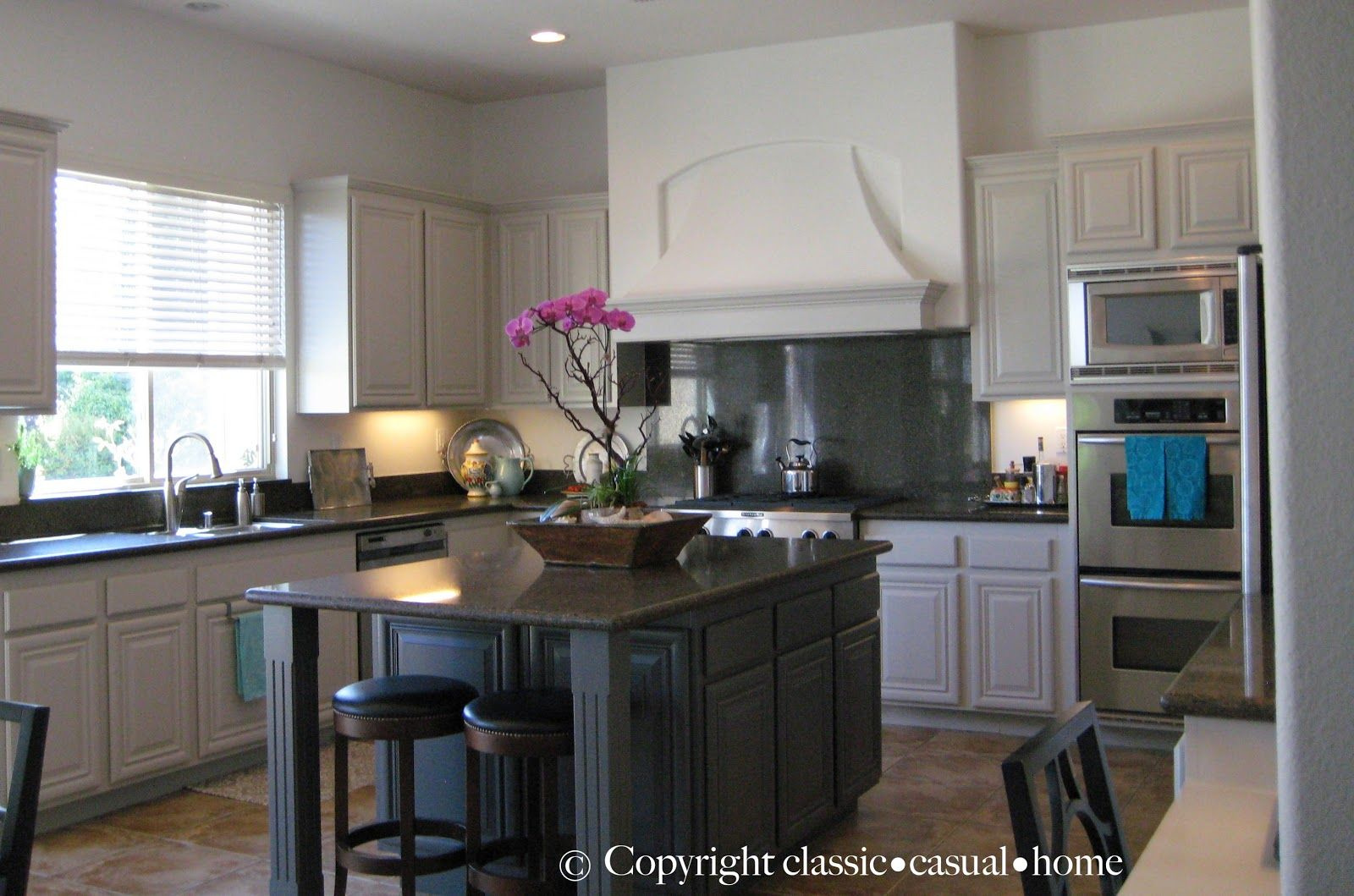 White kitchens with charcoal countertops and khaki walls for Painting kitchen countertops before and after