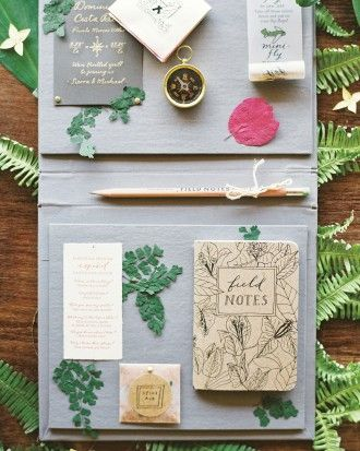 The stationery, by Bryn Chernoff of Paperfinger, were book jackets that held a compass, list of Spanish phrases, and packet of Stuart & Co. spice rub. Follow the link to more images from this Costa Rica wedding!