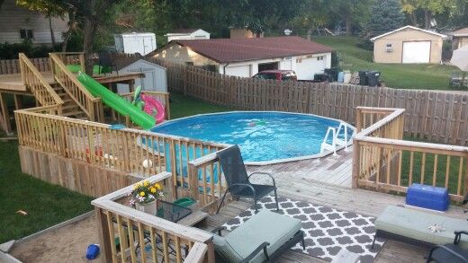 Above ground pool with deck and water slide tree house for Pool platform ideas