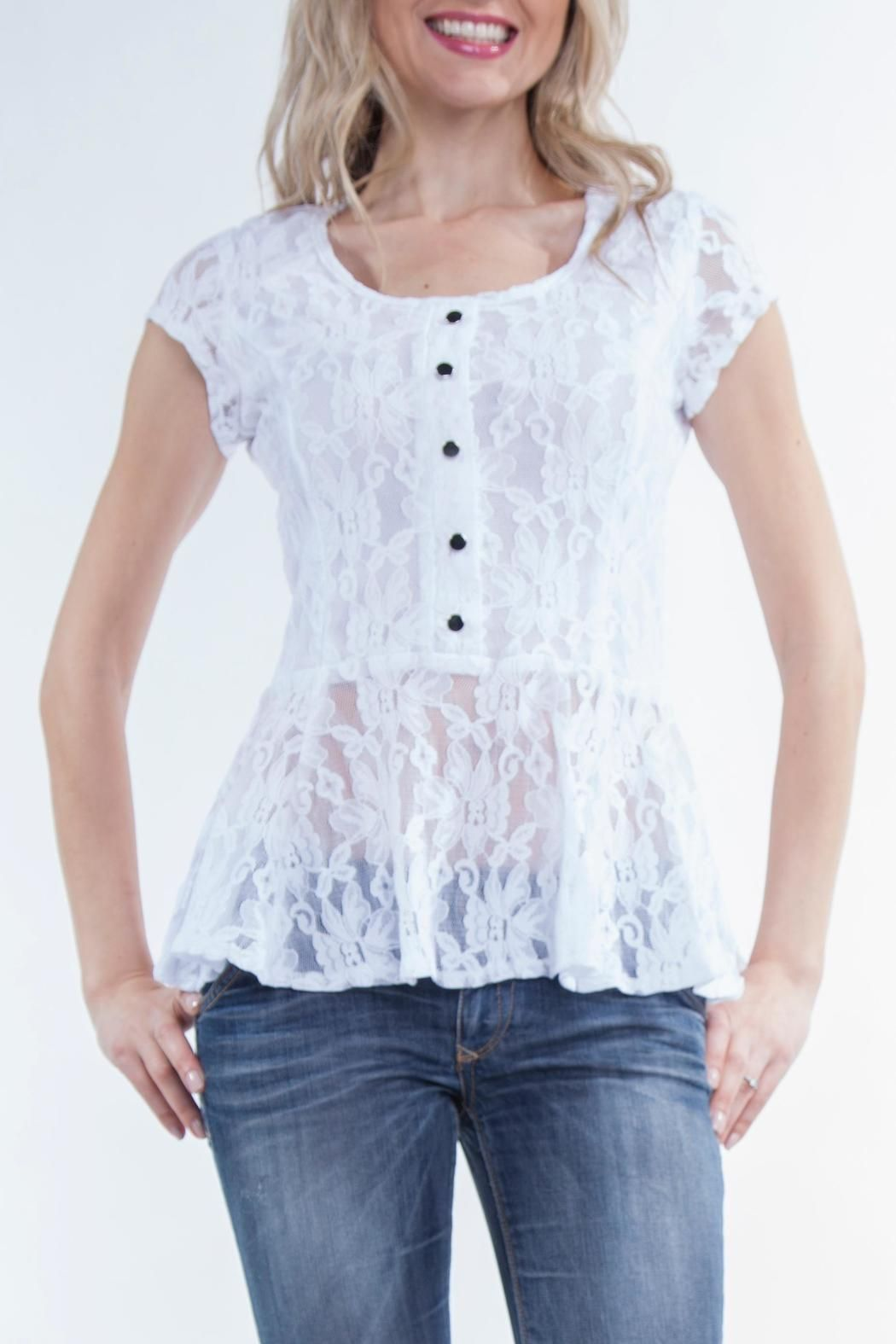Soft stretch lace - Lined front  Faux button detail front   Great with jeans or pants  Dress it up or down  Limited Edition  Designed by Yvonne Marie  Material: Poly/spandex  Made in Canada White-Lace Peplum Top by Yvonne Marie. Clothing Montreal, Canada