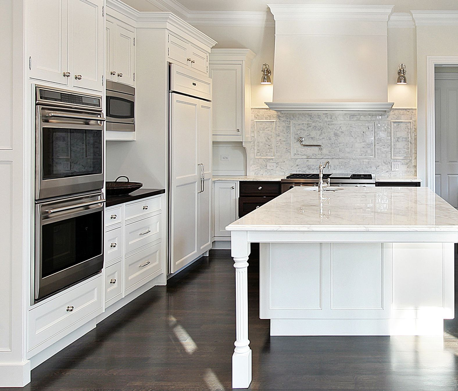Prasada Kitchens And Fine Cabinetry: Lovely White Kitchen With Large Decorative Wood Hood And