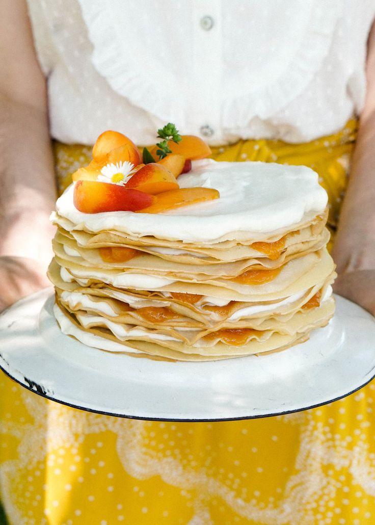 rainbow crepe cake behind tasty