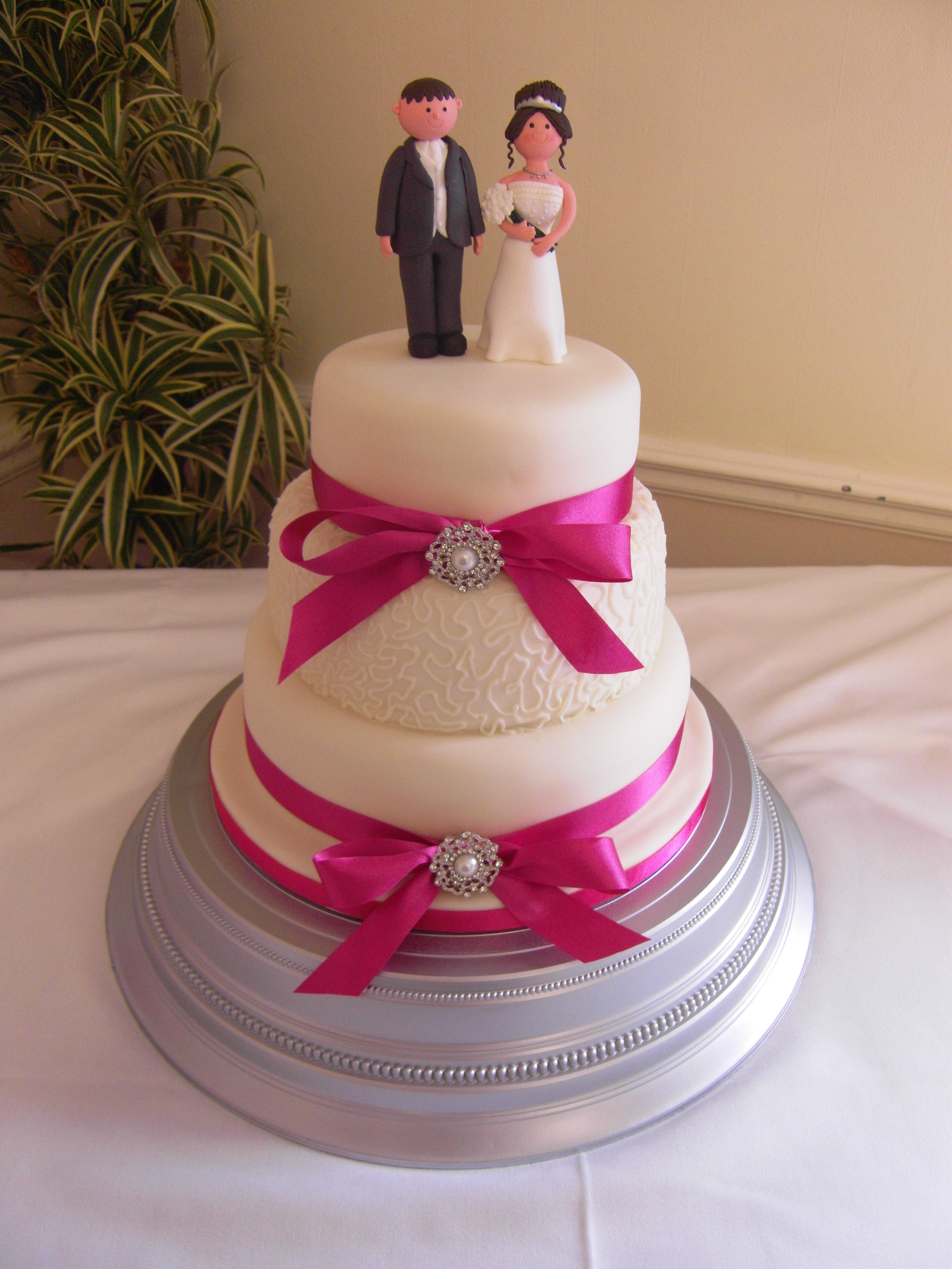 Ivory and hot pink wedding cake with cornelli piping