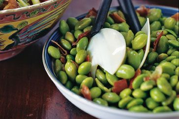 Crispy prosciutto gives a meaty crunch to this delicious edamame bean side.