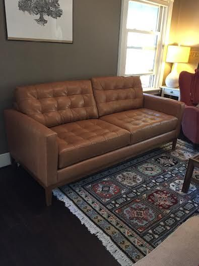 Tufted brown leather modern sofa. Check out other sofa ...