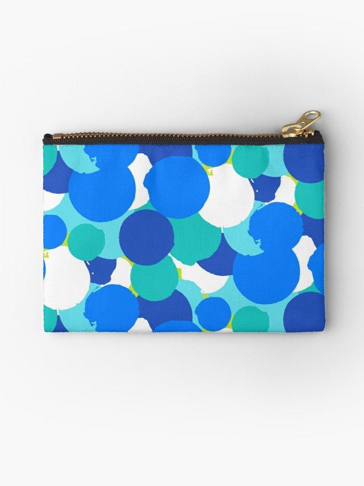 Bold vector polka dot pattern with random hand drawn circles in bright blue green