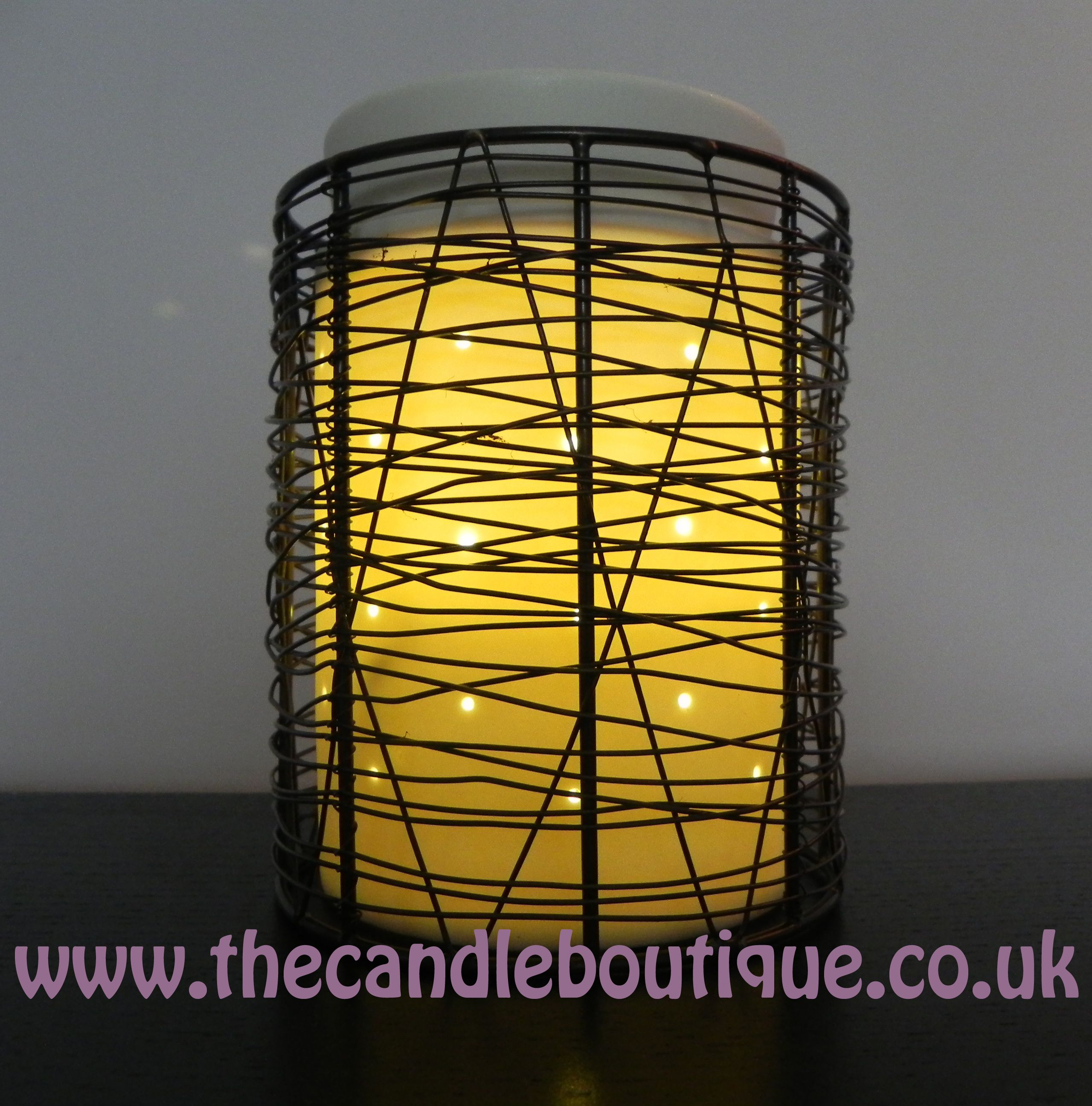 Scentsy Loom Wax Warmer Threads of wire-thin metal are woven into a ...