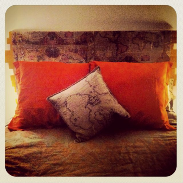 I made this headboard out of old floor boards and antique map tissue paper.