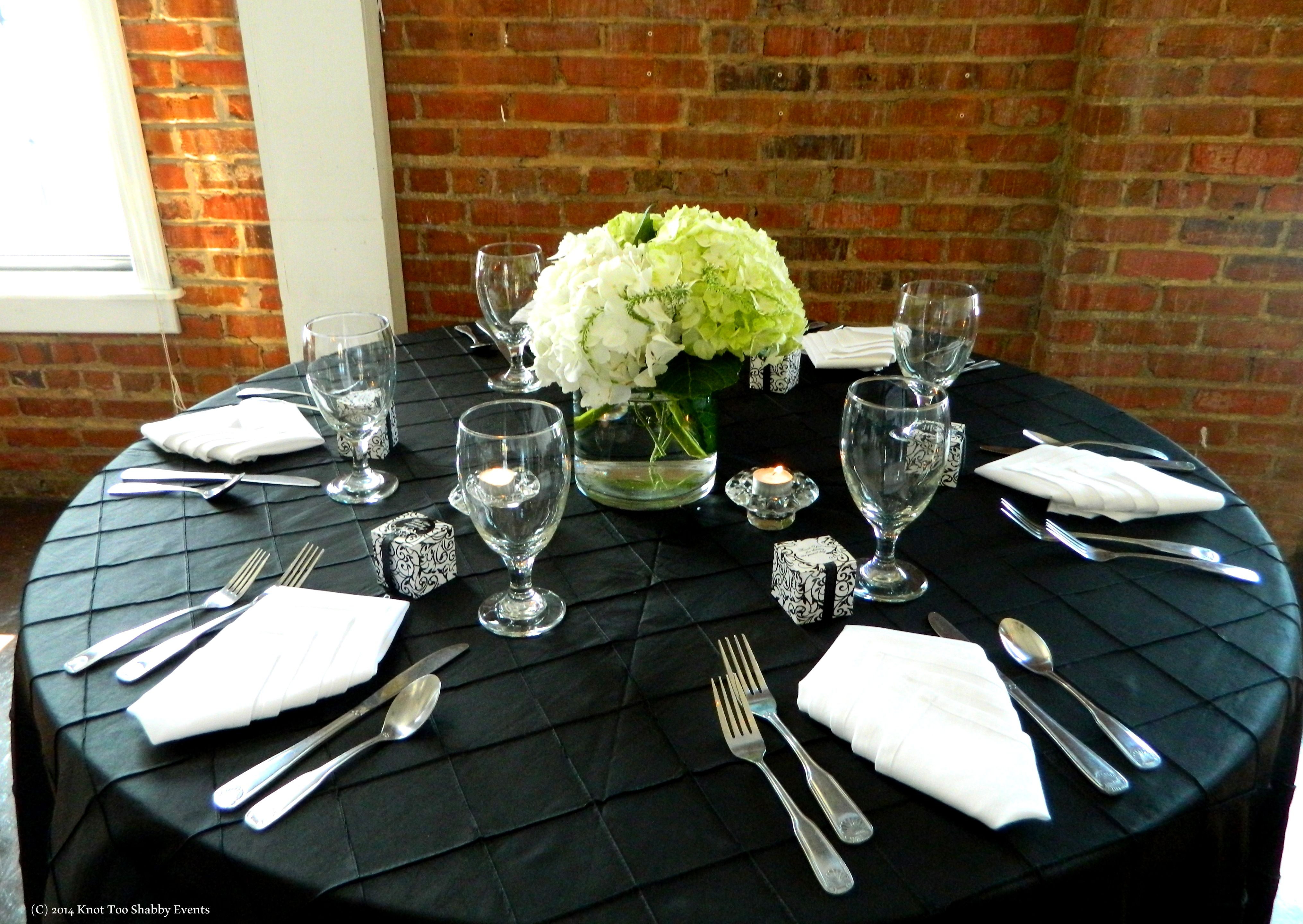 textured linens are a must but the look wouldn't complete with our flowers from Bella Florals by Theresa Linens: Etc. Party Rentals