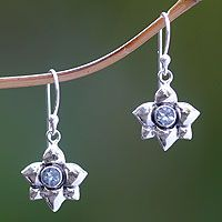 The March birthstone, aquamarine nestles amid sterling petals. Bali's Nyoman Rena crafts shining daffodils to grace elegant silver earrings.  This design features the flower and gemstone for March.
