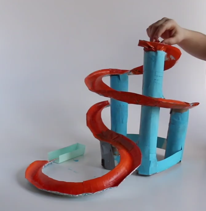 This STEM Activity for kids is great for all ages! This makes a great Elementary STEM Challenge AND Middle School STEM Challenge! This is also a great homeschool STEM Activity!! The only materials you need are paper towel / toilet paper rolls, tape and sturdy paper plates! #stemactivitieselementary