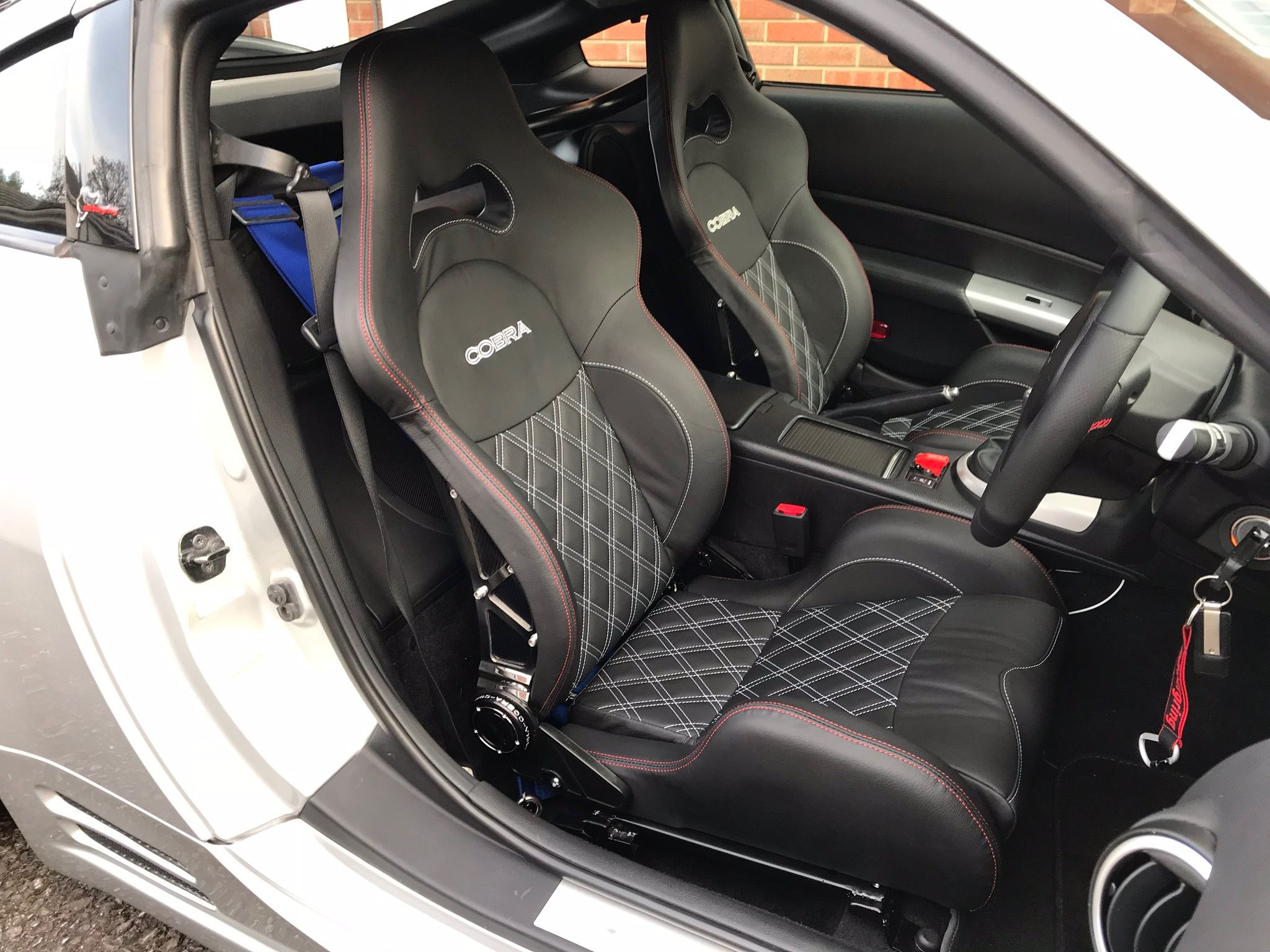 470c07e3a11 Our customer certainly was by fitting these stunning Cobra Misano  Anniversary seats with red stitching and diamond quilting. We love this  setup.
