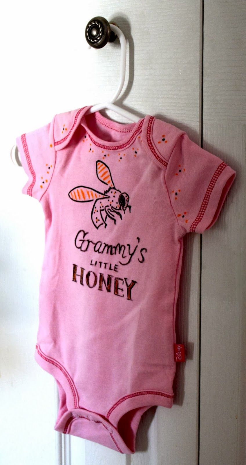 Diy baby onesie project with stencils and fabric markers