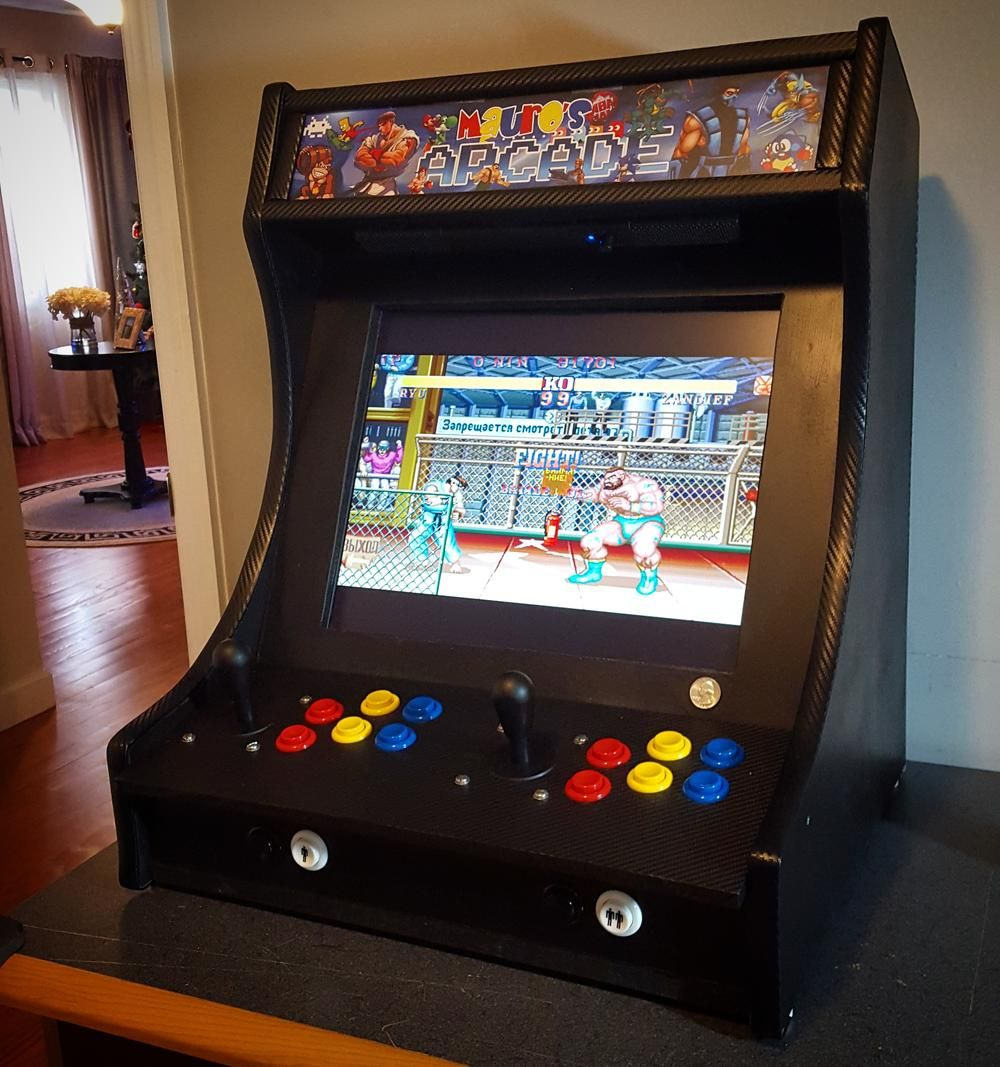 I built a 2 player bartop arcade (powered by Raspberry Pi
