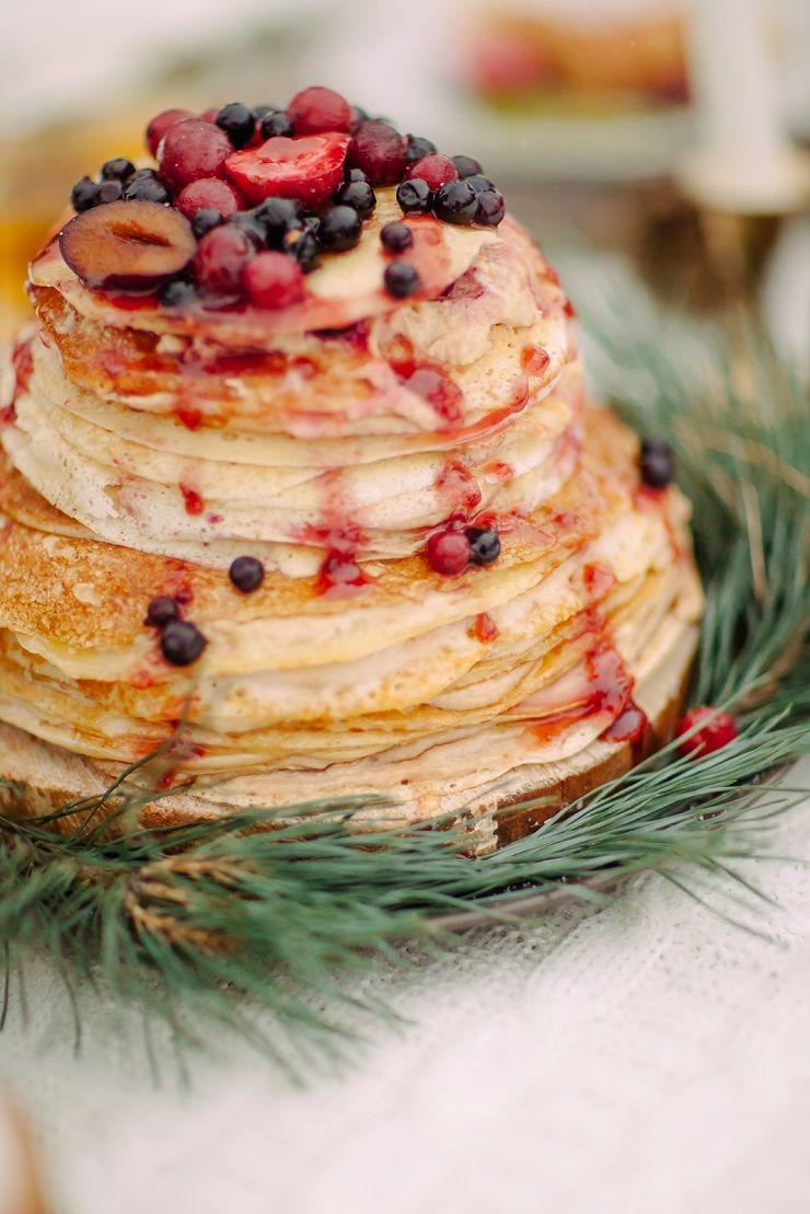 Pancake wedding cake | fabmood.com #wedding #winterwedding #outdoorwedding #snow #bride #weddingcake #peach