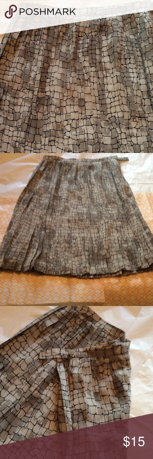 Pleated skirt Georgette type fabric pleated skirt. Labeled 10 fits small at waist. See measurements flat sits at natural waist 14in, hip 18in, 26in length. Great condition. Josephine Chaus Skirts