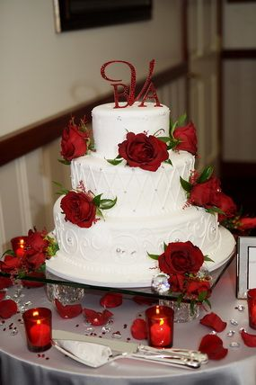 Three Tiered White Wedding Cake With A Monogram Topper Quaint
