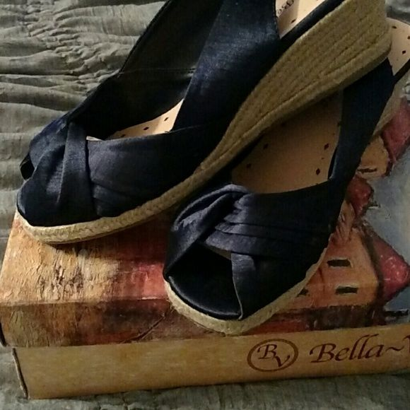 Bella Vita Navy 9 1/2 WW Espadrille wedge. Never worn. Adorable Navy Wedges. Soft silk upper. Soft microfiber lining. Foam cushioned footbed. Purchased these for a cruise and ordered the wrong size. Smoke free home. Bella Vita Shoes Wedges