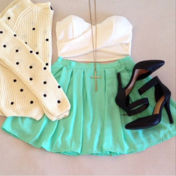 Mint green skater skirt , white strapless crop top , polka dot sweater , black heels , and cross necklace.