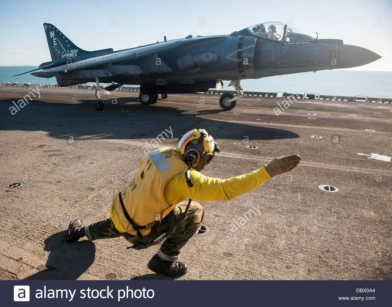 best images about naval aviation museums a us navy aviation boatswain s mate signals the pilot of an av 8b